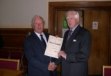 GP Chairman John Kingston receives the Certificate from David Guy.